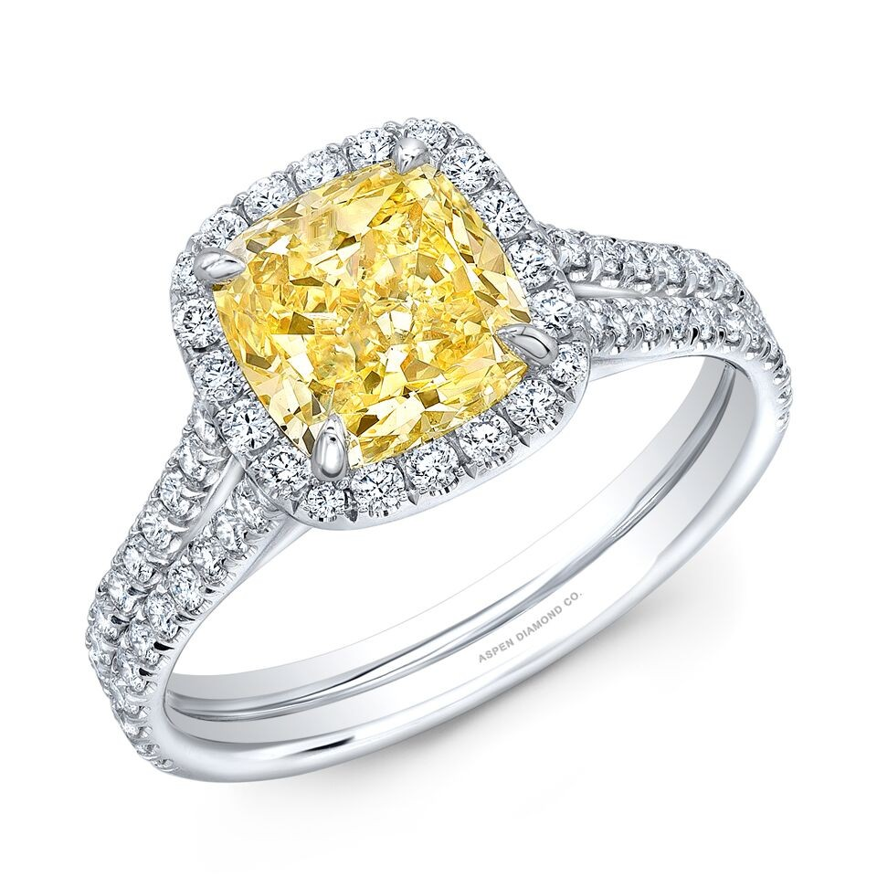 Cushion Cut Fancy Yellow Diamond Halo Engagement Ring in Platinum
