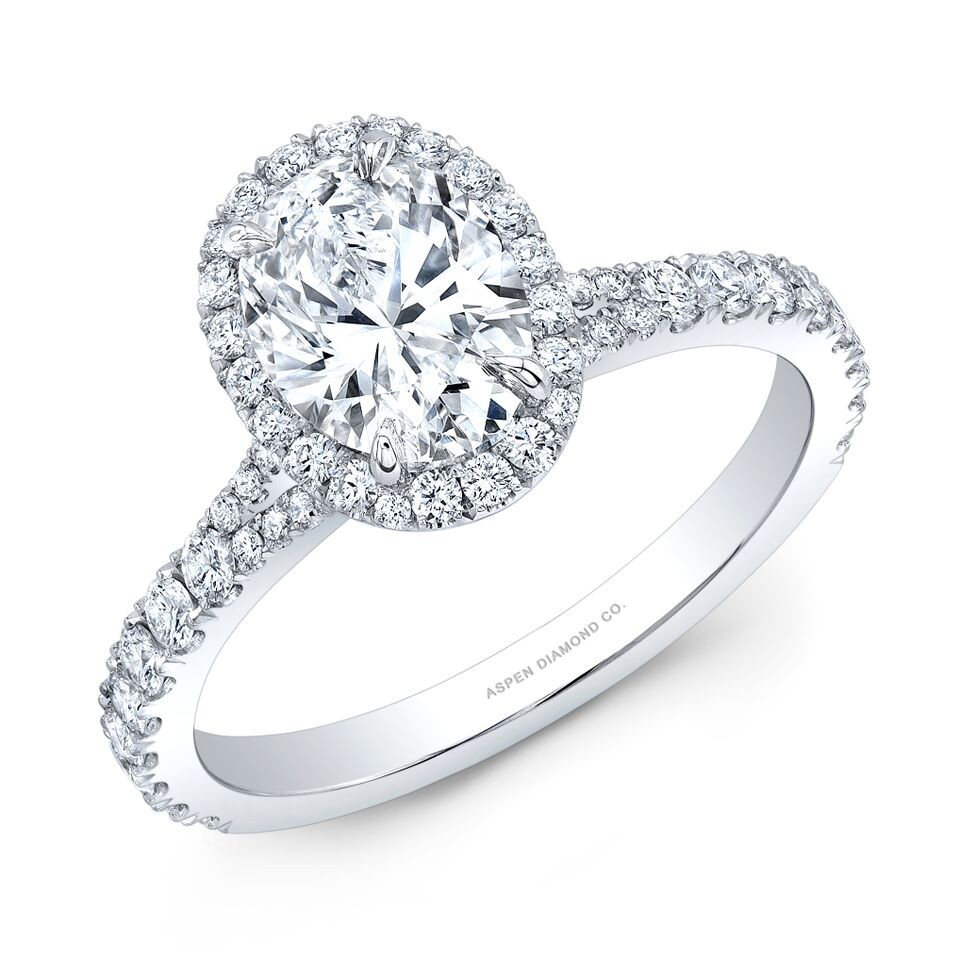 Oval Diamond Halo Engagement Ring in Platinum
